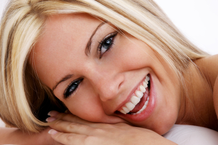A woman smiling with a beauttiful smile