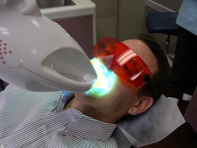 Patient under a zoom whitening light